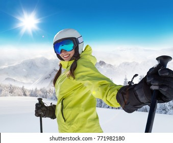 Happy young woman skier enjoying sunny weather in Alps. Winter sport and recreation, leasure outdoor activities.