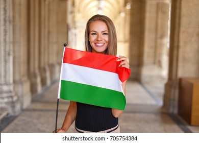 Happy young woman smile with hungarian flag