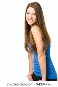 Happy young woman smiling at camera. Hands in jeans