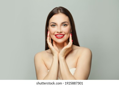 Happy young woman spa model with clear skin on white background