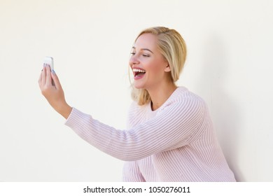 Happy young woman  speaks by phone