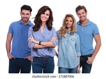 happy young woman standing with hands folded in front of her casual team of students