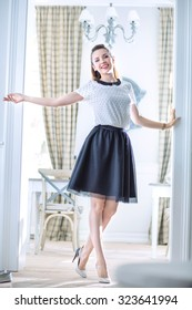 Happy young woman in a stylish interior