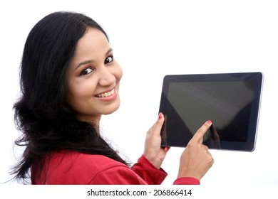 Happy young woman with tablet computer against white background
