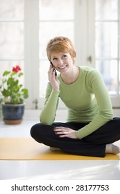 Happy young woman talking on a cell phone