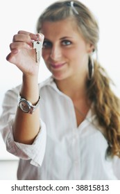 happy young woman throw keys from their apartment and home in ai and representing concept of joy and financial freedom