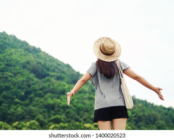 Happy young woman travel relax in the holiday. Travel hiking. Travel and wanderlust concept.