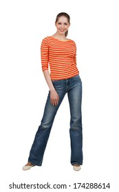 Happy young woman in t-shirt and blue jeans
