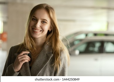 happy young woman at underground parking smiling