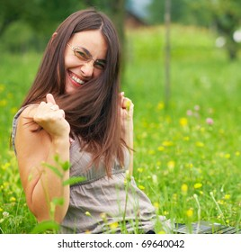 Happy Young woman using her laptop outdoors.