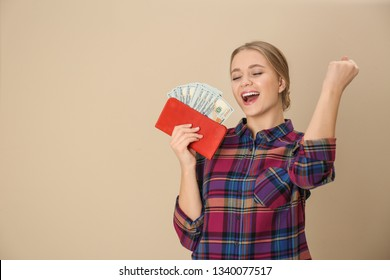 Happy young woman with wallet full of money on color background. Space for text