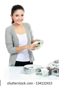 Happy Young Woman Washing Dishes in the kitchen isolated over white background