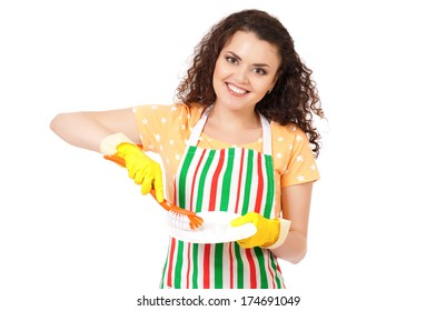 Happy young woman washing dishes, isolated on white background