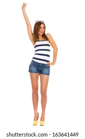 Happy young woman waving hand. Full length studio shot isolated on white.