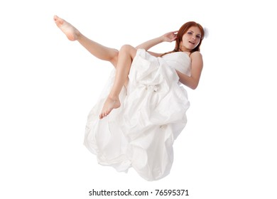 Happy young woman in a wedding dress on a white background.