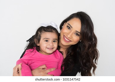 Happy young woman who is with her daughter