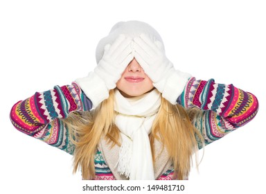 Happy young woman in winter clothes closing eyes