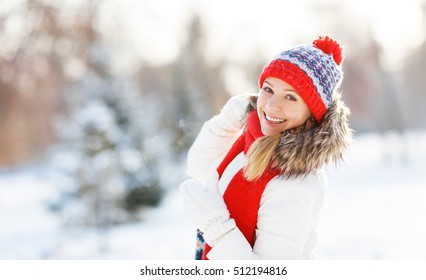 happy young woman in winter for a walk in nature