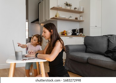 Happy young woman working from home with child. Home office. Quarantine