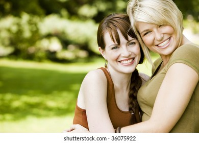 Happy young women embracing each other in the park