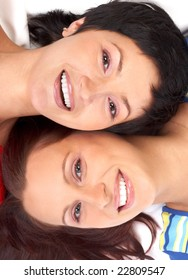 Happy young women friends smiling.  Over white background