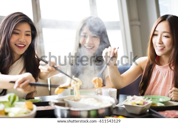 happy young Women group  Eating hot pot
