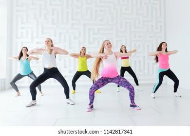 Happy young women having a fitness dance class in the dance studio