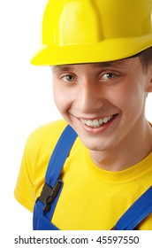 Happy young worker fold his arms, dressed in blue-and-yellow uniform and hard hat, isolated over white