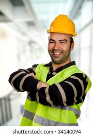 happy young worker inside a modern building