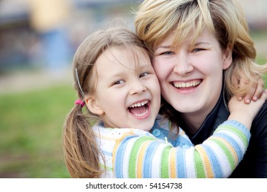 happymum with a daughter embrace and laugh