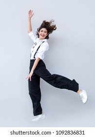 hapyp face from asian lady jumping on blank background. Happy people action with healthy face with good.
