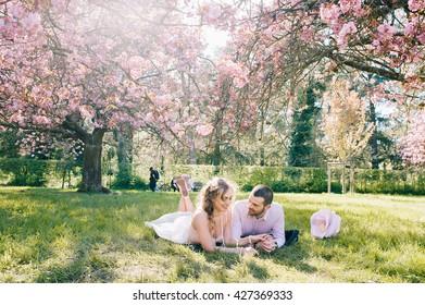 Hapyy loving couple under the cherry blossom trees.