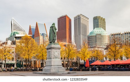 The Haque / 11-6-2018: Panorama photo of the statue of William of Orange on het Plein in the Hague in autumn tones with the sky-line in the background
