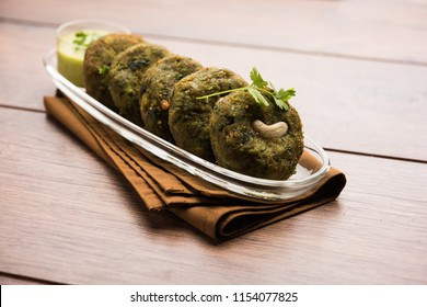 Hara bhara Kabab or Kebab is Indian vegetarian snack recipe made using spinach, potatoes and green peas and spices, selective focus