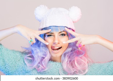 Harajuku e-girl soft girl fashion young woman with pastel blue and pink hair wig, tongue sticking out, blue eyes, peace gestures funny facial expressions