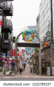 Harajuku, Tokyo / Japan - June 2018:  Crowds fill the famous shop lined Takeshita Street in Harajuku district of Tokyo.