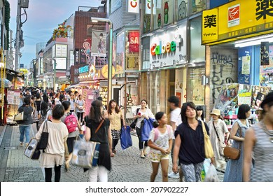 HARAJUKU, TOKYO - JULY 26, 2014: Takeshita Street, pedestrian street with many fashion boutiques, groceries, restaurants and cafes. Takeshita Dori is very popular among younger generations.