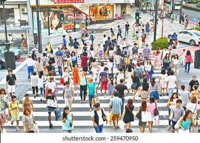 HARAJUKU, TOKYO - JULY 26, 2014: Pedestrian crossing in the corner of La Foret Harajuku fashion building and Tokyu Plaza shopping complex in Omotesando and Harajuku area, downtown Tokyo.