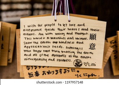 Harajuku/Tokyo / Japan - June 16, 2018:  Wooden prayer plaques hanging in the Meiji-jingu Temple, a Shinto Shrine in busy city of Tokyo.