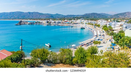 Haraki beach with apartment houses and holiday makers enjoying their time (Rhodes, Greece)