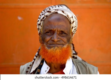 HARAR, ETHIOPIA - CIRCA NOVEMBER 2015: A portrait of an old Harari Muslim man from the Oromo tribe proudly wearing a ginger beard that he has dyed using henna.