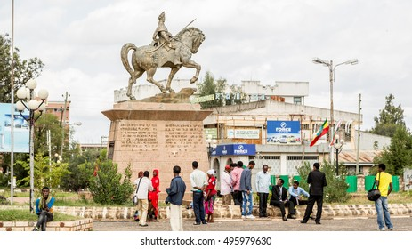 HARAR, ETHIOPIA - JULY 27,2014: Tourists gather around the statue of Ras Makonnen Wolde Michael Guddisa, father of Emperor Haile Selassie I (Tafari Makonnen), to have their pictures taken.