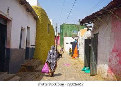 HARAR, ETHIOPIA - JUNE 3, 2017 : People Walk Along the Colorful Walled Streets in the Old City, Harar, Ethiopia