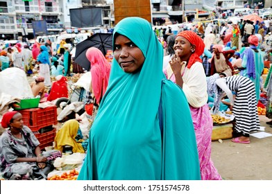 HARAR (Harer), ETHIOPIA – August 2018. Women and colors of Harar, Ethiopia, Africa. Non-posed photo shots of everyday life in Harar (Eastern Ethiopia, Somali Upland). Inscribed in the UNESCO in 2006