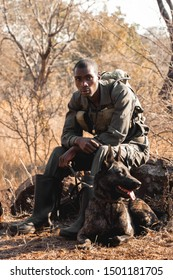 Harare, Zimbabwe - August 8th 2019: Learnmore and the dutch shepherd Murwi, two members of the anti-poaching unit at Imire Rhino & Wildlife Conservation.