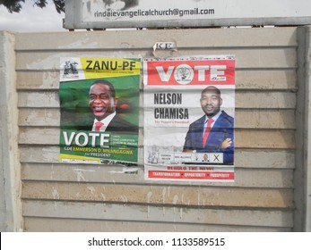 Harare,Zimbabwe,10 July 2018. Election campaign posters  of  the  two  front  runners  Emerson  Mnangagwa  and  the  main  opposition party leader Nelson Chamisa  at  a  roadside.