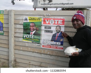 Harare,Zimbabwe,10 July 2018. A  main showing his presidential candidate for  the  elections  on  campaign posters  of  the  two  front  runners  in the elections.