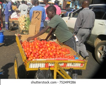 Harare,Zimbabwe,15 August 2017.  A  street  scene  in  Harare  showing  fruit  and  vegetable  vendors  who  are sorting  up  and  selling  their  products..