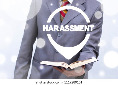 Harassment. Woman Discrimination. Man offers book with location harassment word. Education and Learning Ethics.