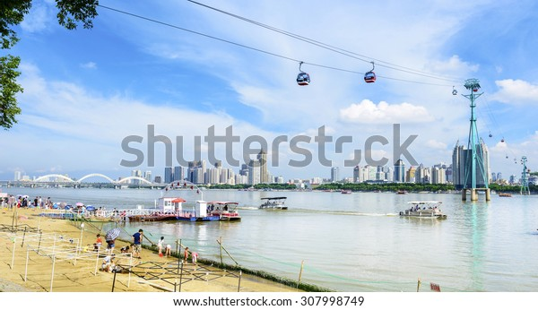 Harbin, China - August 9, 2015: Songhua River and Harbin City. People are visiting and playing. Located in Harbin City, Heilongjiang Province, China.